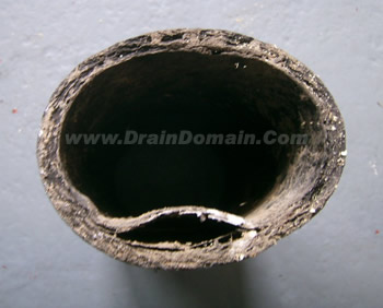 .draindomain.com_blistered pitch fibre pipes & pitch fibre pipe work why it fails and blocks and are you insured